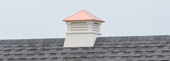 Square vinyl cupola with copper roof.