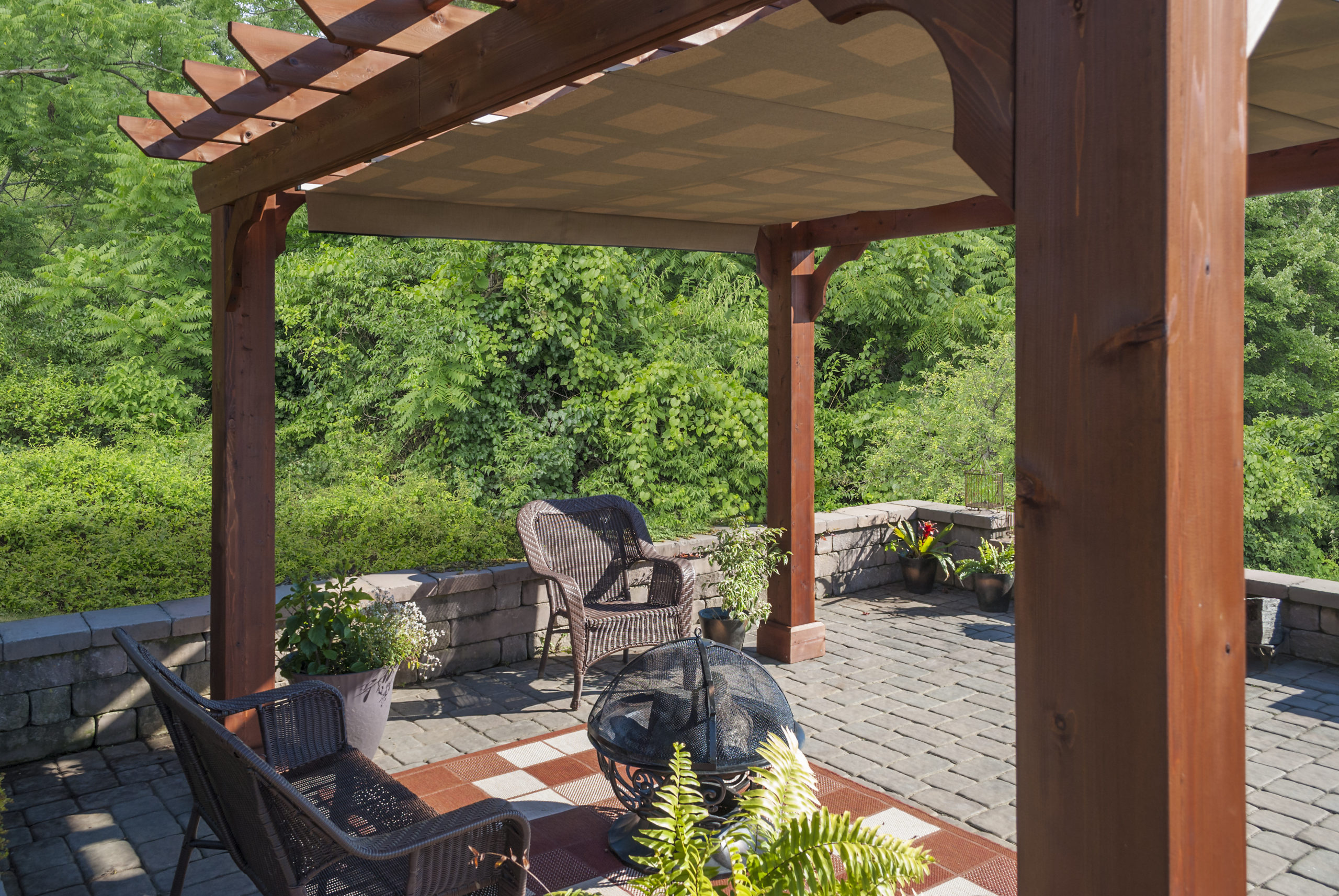 Wooden pergola with an EZShade canopy.